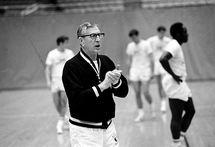 John Wooden claps his hands in encouragement of his players in a practice session